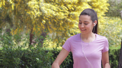 young woman jogging outdoors - stock footage