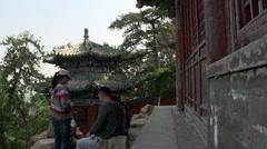People sitting around the pagoda Stock Footage