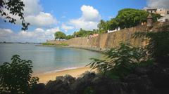 A beautiful view overlooking the beach with a fort on a cliff in the background Stock Footage