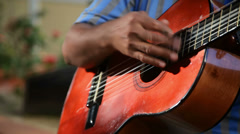 A man plays guitar on the street for money Stock Footage