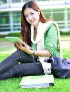 asian women student learning with computer tablet - stock photo