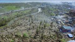 Flight over the outskirts of a destroyed town after typhoon Haiyan Stock Footage