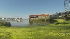 Old boats tide coming in and clouds 01 Stock Footage
