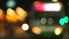 Out of focus traffic of public transportation at night Stock Footage