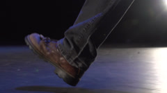Work boots walking across stage Stock Footage