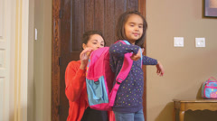 A little girl and her mom leave the house for school Stock Footage