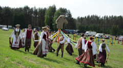 Cheerful people dance around horse figure in festival Run Horse Stock Footage