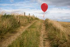 Balloon above sand dunes - stock illustration