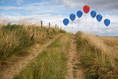 Balloons above sand dunes - stock illustration