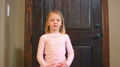 An adorable little girl spins and dances in a ballet uniform in her house Arkistovideo