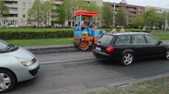 Heavy road street repair equipment and workers Stock Footage