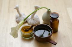 An arrangement of spice, oil and massaging tools used in Ayurveda massage - stock photo