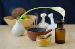 An arrangement of spice, oil and massaging tools used in Ayurveda massage Stock Photos