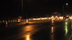 Night traffic and construction cones WS Stock Footage