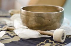 A Tibetan singing bowl with baton - stock photo