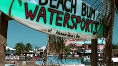 Cayman Islands, hand painted water sport sign that looks like a surfboard Stock Footage