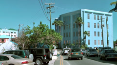 Cayman Islands, zoom to a blue painted office block Stock Footage