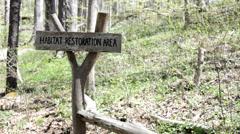 Habitat restoration area sign in woods Stock Footage