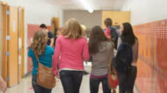 Students hurry down the hallway to get to their classrooms for the next period - stock footage