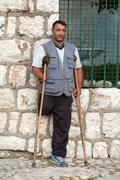 Redzep Osmani, land mine victim, lost his hand and leg on land mine after war Stock Photos