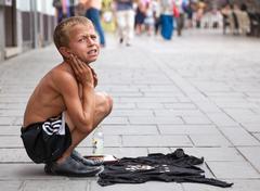 Sevdalija Osmanovic, 10 years old, sings on street to bypassers in Sarajevo - stock photo