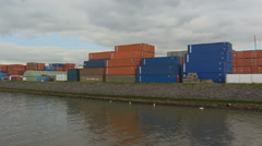 Sailing along Port of Rotterdam - container stowage in Eemhaven Stock Footage