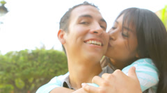 Close up of a woman giving a man a kiss on the cheek from behind Stock Footage