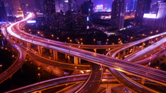 Time lapse busy urban traffic with streaking lights trail at night,shanghai. Stock Footage