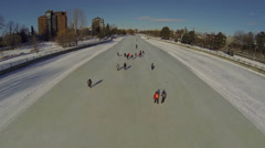 Aerial shot of skaters on Ottawa's Rideau Canal Stock Footage