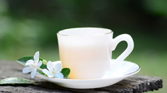 Hot tea with flower in morning time Stock Footage