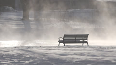 Empty bench by steaming river (handheld) Stock Footage