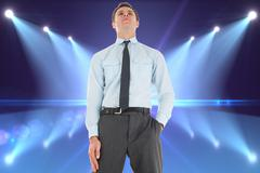 Stock Illustration of Composite image of serious businessman standing with hand in pocket