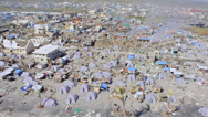 Stock Video Footage of Aerial of refugee tents in midst the destroyed town