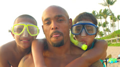 A father with sons in snorkel masks Stock Footage