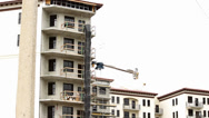 Stock Video Footage of Downtown construction on condos-tilt shot