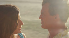 An older couple hug and dance as they stand in the water at the beach, close up Stock Footage