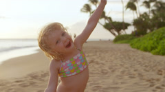 A little girl looks at the camera while dancing around and making funny faces Stock Footage