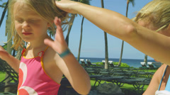 A mother applies some sunscreen on her daughters back Stock Footage