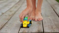 Kid Girl Feet on Wooden Deck Playing Child Toy Car HD Stock Footage