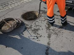 sewerage worker - stock photo