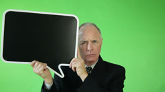 Senior caucasian business man green screen angry with blank sign Stock Footage