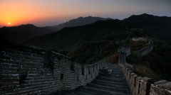 Sun rising over Great Wall stone fortifications, Mutianyu nr Beijing, China, T/L Stock Footage
