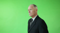Senior caucasian business man green screen with conductor's baton Stock Footage