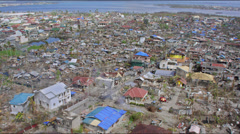 Aerial view of destroyed town after typhoon Haiyan Stock Footage