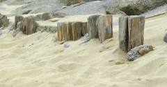 Wooden posts in the sand Stock Footage