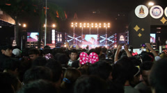 Spectators at music festival during New Year celebration Stock Footage