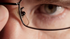 Man leaning in to look into camera with glasses Stock Footage