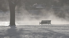 Empty bench by steaming river Stock Footage