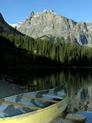 Canoe on a shore of emerald lake, yoho national park, canada Stock Photos