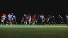 A football player catching a pass down the middle of the field for a touchdown Stock Footage
